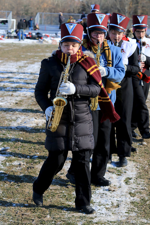 . Littleton High School visited Ayer Shirley Regional High School on Thanksgiving Day for there annual turkey day game. ASRHS\'s band member junior julia Alo playes the saxophone with the band during the half time show. SENTINEL & ENTERPRISE/JOHN LOVE