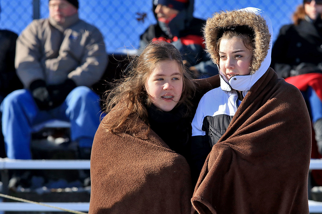 . Littleton High School visited Ayer Shirley Regional High School on Thanksgiving Day for there annual turkey day game. ASRHS freshman cheerleaders Emily Granger and amber Maki try to stay warm during the game. SENTINEL & ENTERPRISE/JOHN LOVE