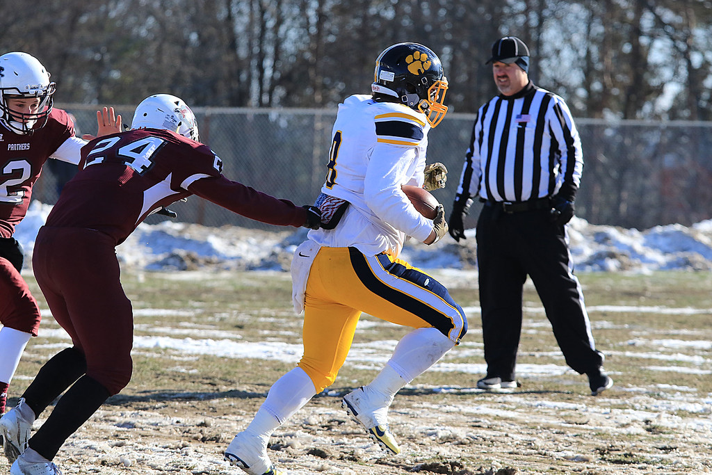 . Littleton High School visited Ayer Shirley Regional High School on Thanksgiving Day for there annual turkey day game. LHS\'s Mitch Beaudoin finds some running room and runs for a touchdown during the first quarter of the game. SENTINEL & ENTERPRISE/JOHN LOVE