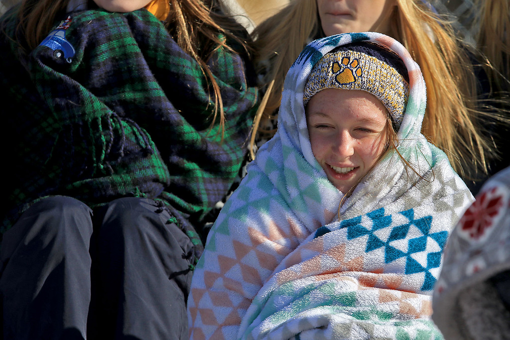 . Littleton High School visited Ayer Shirley Regional High School on Thanksgiving Day for there annual turkey day game. LHS cheerleader Sydney Lussier tries to stay warm at the game. SENTINEL & ENTERPRISE/JOHN LOVE