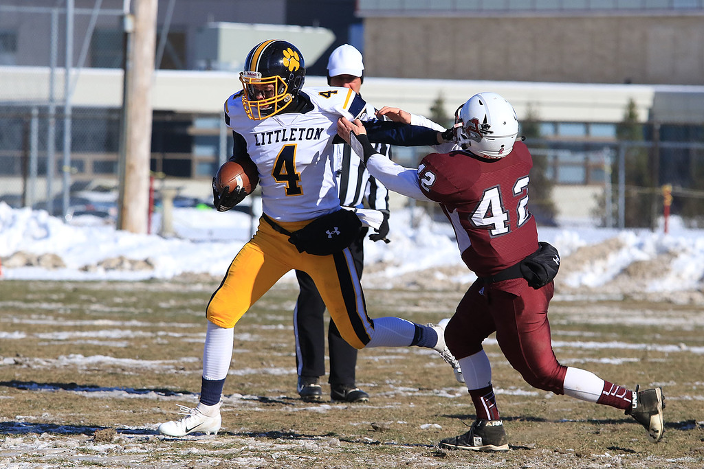 . Littleton High School visited Ayer Shirley Regional High School on Thanksgiving Day for there annual turkey day game. ASRHS Mick Mitrano goes after LHS\'s Austin Lynn during action in the game. SENTINEL & ENTERPRISE/JOHN LOVE