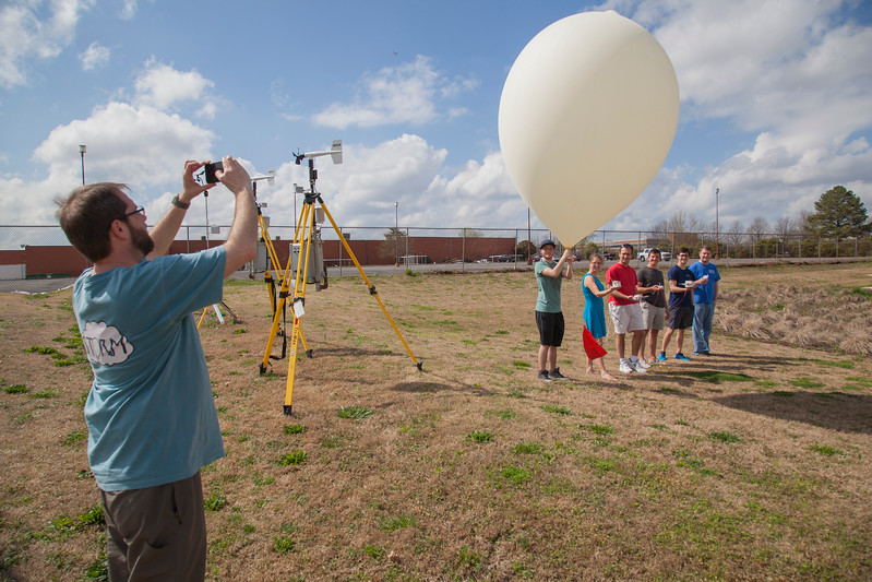Ryan Wade from UAH taking a picture of the balloon just before release.