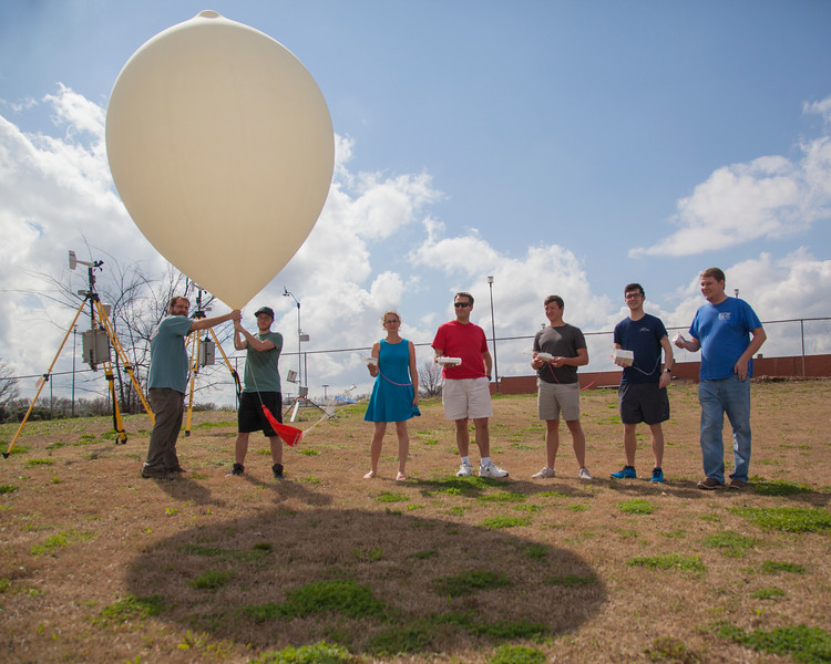All lined up and ready to launch!  Representatives from each team that participated in the comparison are shown.  Left to right: Texas Tech University, NOAA/ARL/ATDD, Colorado State University, University of Louisiana Monroe, and University of Alabama in Huntsville