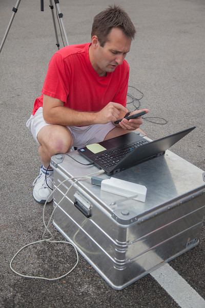 Temple Lee of NOAA/ATDD preparing the Graw radiosonde package for the comparison flight.