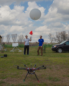 ATDD's DJI S-1000 small UAS (foreground), University of Louisiana Monroe's microwave radiometer (background left) and ATDD's Graw radiosonde and balloon being readied for launch.