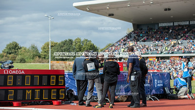 IAAF DIAMOND LEAGUE-Birmingham Men-Two Miles Mo Farah crosses the line in a new world record time of 8:07:85 being interviewes by TV crews