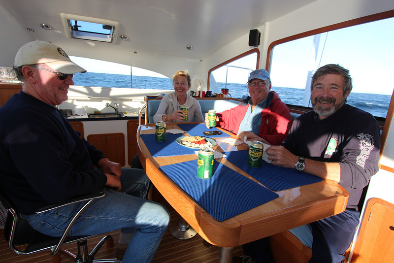Happy hour, even better when sailing toward the warmth. <br /> Left to right, Thom, Ann, Larry, Mike
