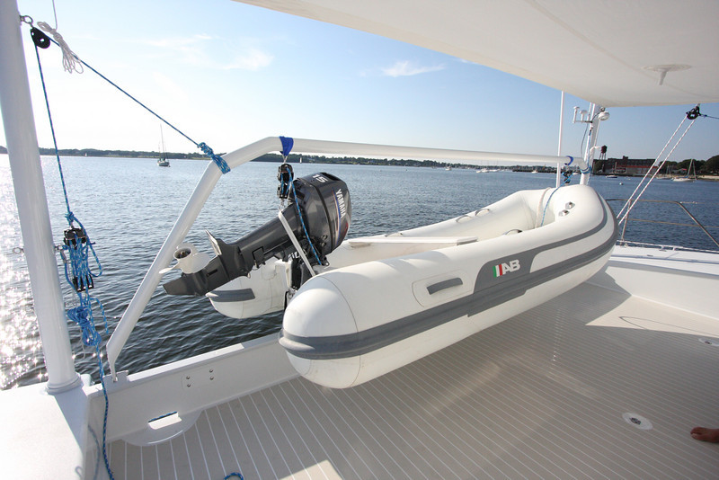 """A 12' dinghy can be launched or loaded by one person using the simple """"pivoting hoist"""" that CWD developed for the Atlantic 55."""