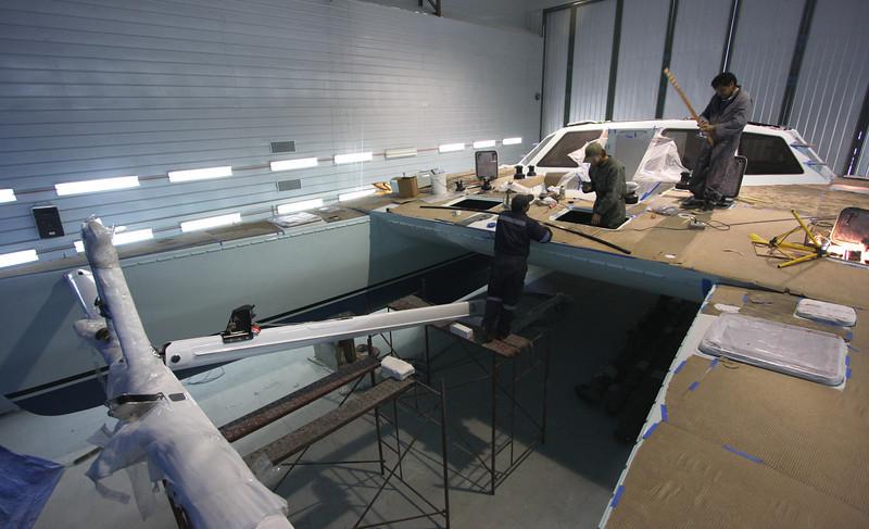 Installing carbon fiber spars and other deck hardware
