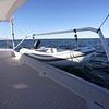 The dinghy can be carried behind the aft deck like conventional davits or securely placed on deck for offshore sailing.
