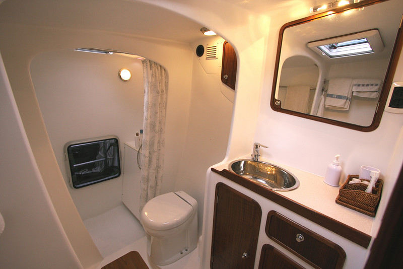 Port hull vanity, head and shower. Ample space, large separate shower stall.
