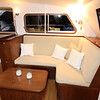Pilothouse port settee,  coffee table with stowage, stowage lockers under seats, wine locker at inboard end of seat.
