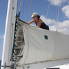 Kate tending the sail cover, Javelin