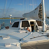 The mainsail falls into the stack pack and the cover can be tweaked and zipped by jumping up to the pilothouse top.<br /> Two large steps are on each side of the pilothouse and provide easy access.
