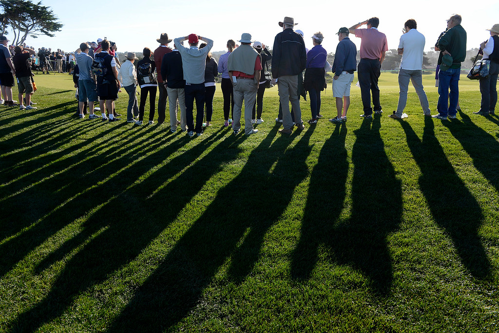 . Patrons around the 14th green at Monterey Peninsula Country Club Shore Course during the second round of the AT&T Pebble Beach Pro-Am on Friday, Feb. 9, 2018.  (Vern Fisher - Monterey Herald)
