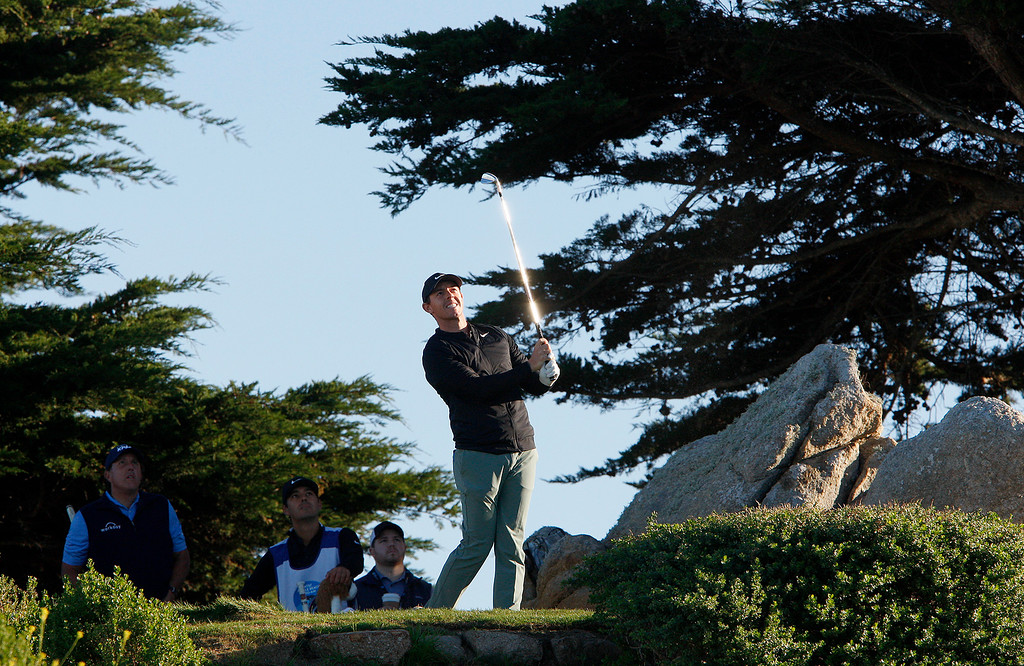 . Rory McIlroy tees off on the 11th hole at Monterey Peninsula Country Club Shore Course during the second round of the AT&T Pebble Beach Pro-Am on Friday, Feb. 9, 2018.  (Vern Fisher - Monterey Herald)