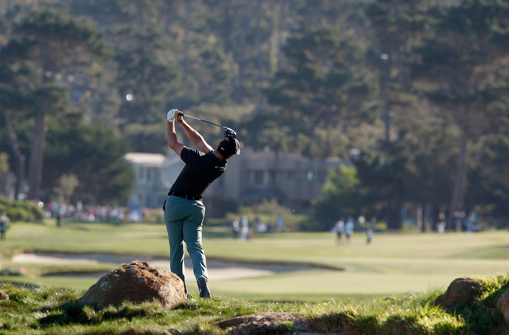 . Rory McIlroy tees off on the 16th hole at Monterey Peninsula Country Club Shore Course during the second round of the AT&T Pebble Beach Pro-Am on Friday, Feb. 9, 2018.  (Vern Fisher - Monterey Herald)