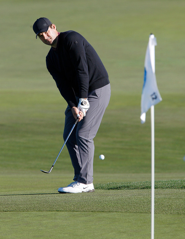 . Tony Romo chips on to the 12th hole green at Monterey Peninsula Country Club Shore Course during the second round of the AT&T Pebble Beach Pro-Am on Friday, Feb. 9, 2018.  (Vern Fisher - Monterey Herald)