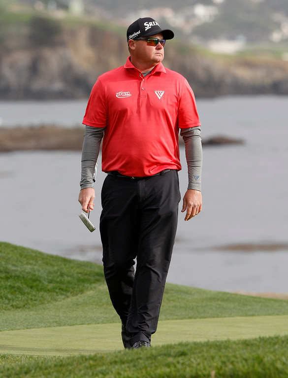 . Ted Potter Jr. on the 18th hole at the Pebble Beach Golf Links during the final round of the AT&T Pebble Beach Pro-Am on Sunday, Feb. 11, 2018.  Potter went on to win the tournament by three strokes with a -17.  (Vern Fisher - Monterey Herald)