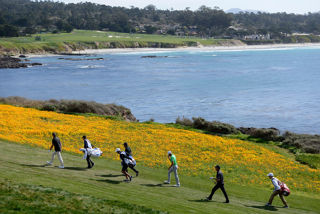 . Troy Merritt and Jason Day walk up the 8th hole fairway at the Pebble Beach Golf Links during the final round of the AT&T Pebble Beach Pro-Am on Sunday, Feb. 11, 2018.  (Vern Fisher - Monterey Herald)