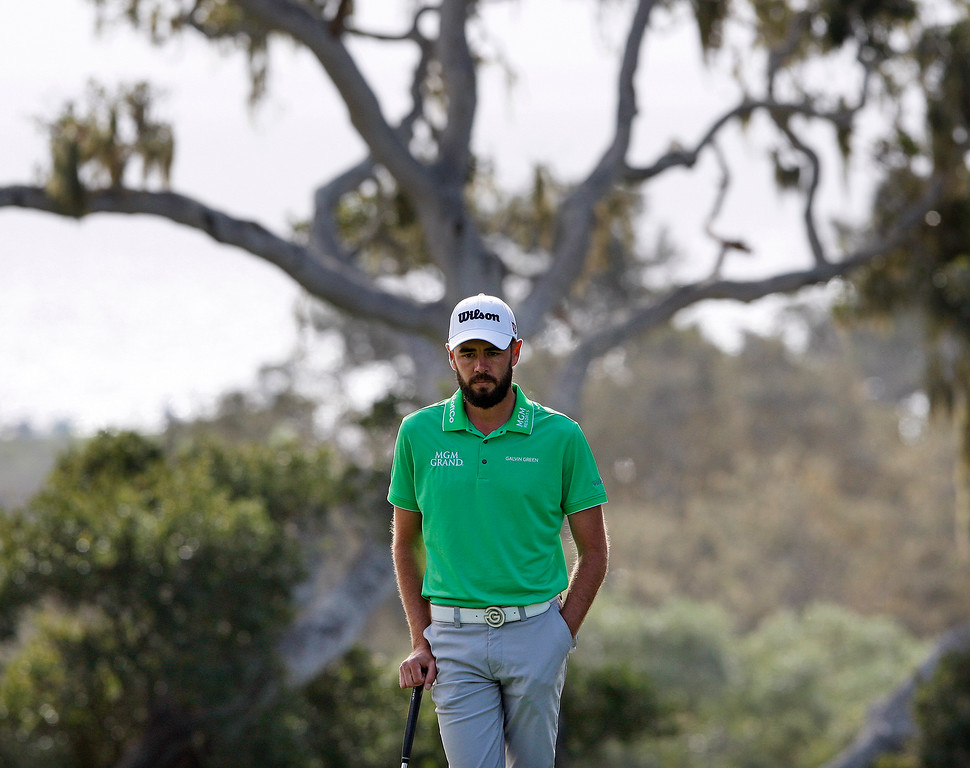 . Troy Merritt lines up a putt on the 14th hole at the Pebble Beach Golf Links during the final round of the AT&T Pebble Beach Pro-Am on Sunday, Feb. 11, 2018.  (Vern Fisher - Monterey Herald)