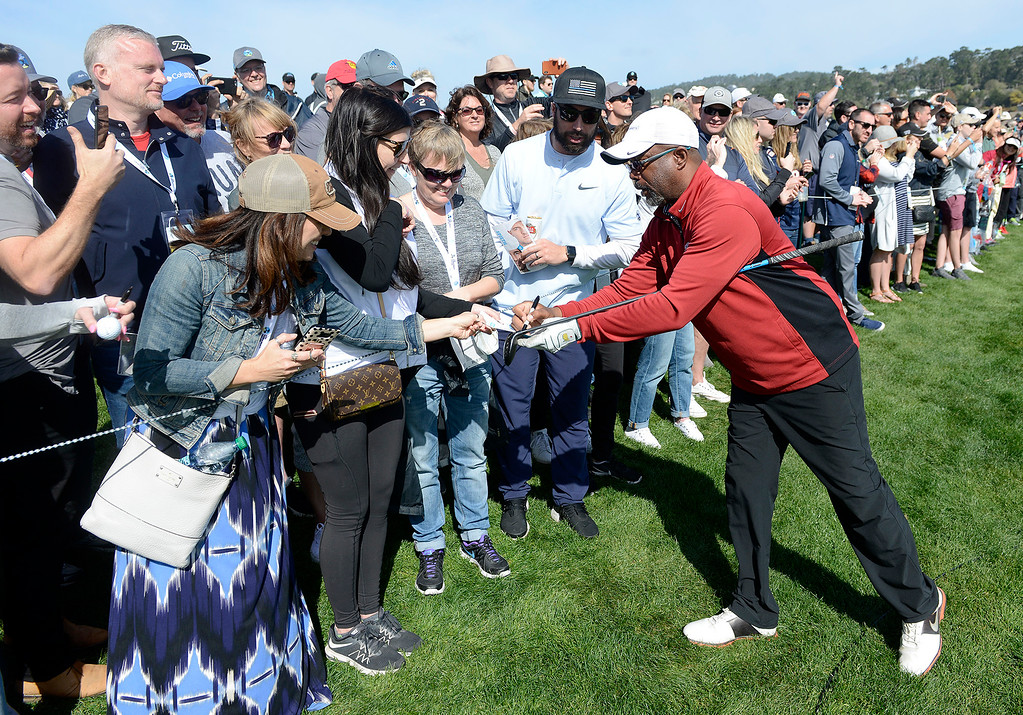 . Darius Rucker signs autographs on the 8th hole at the Pebble Beach Golf Links during the third round of the AT&T Pebble Beach Pro-Am on Saturday, Feb. 10, 2018.  (Vern Fisher - Monterey Herald)