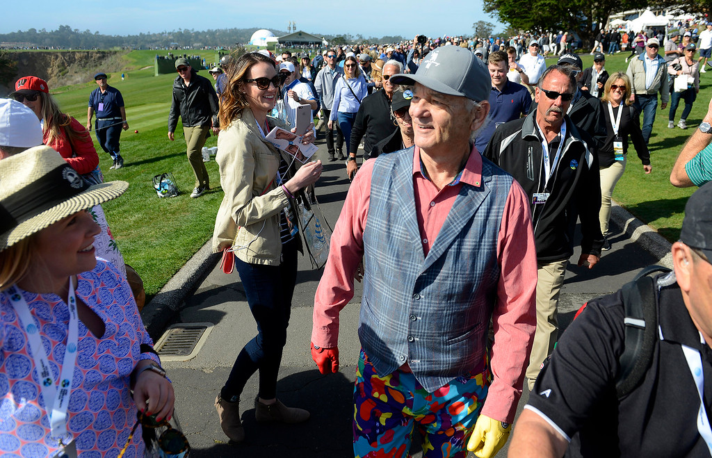 . Bill Murray greets fans as he walks the 9th hole at the Pebble Beach Golf Links during the third round of the AT&T Pebble Beach Pro-Am on Saturday, Feb. 10, 2018.  (Vern Fisher - Monterey Herald)