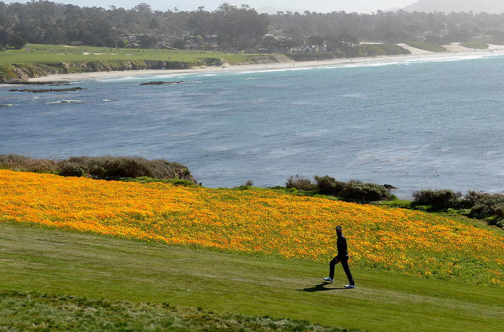 . Dustin Johnson walks up the 8th hole fairway at the Pebble Beach Golf Links during the third round of the AT&T Pebble Beach Pro-Am on Saturday, Feb. 10, 2018.  (Vern Fisher - Monterey Herald)