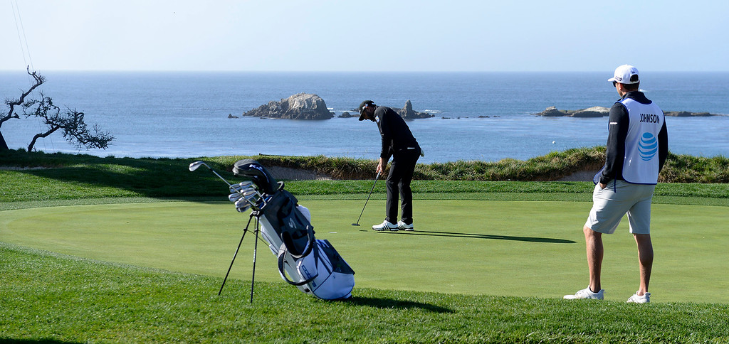 . Dustin Johnson putts on the fourth hole at the Pebble Beach Golf Links during the third round of the AT&T Pebble Beach Pro-Am on Saturday, Feb. 10, 2018.  (Vern Fisher - Monterey Herald)