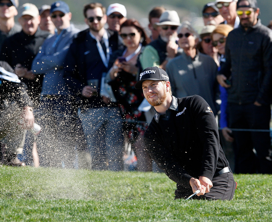 . Chris Stroud hits from a bunker on the 6th hole at the Pebble Beach Golf Links during the third round of the AT&T Pebble Beach Pro-Am on Saturday, Feb. 10, 2018.  (Vern Fisher - Monterey Herald)