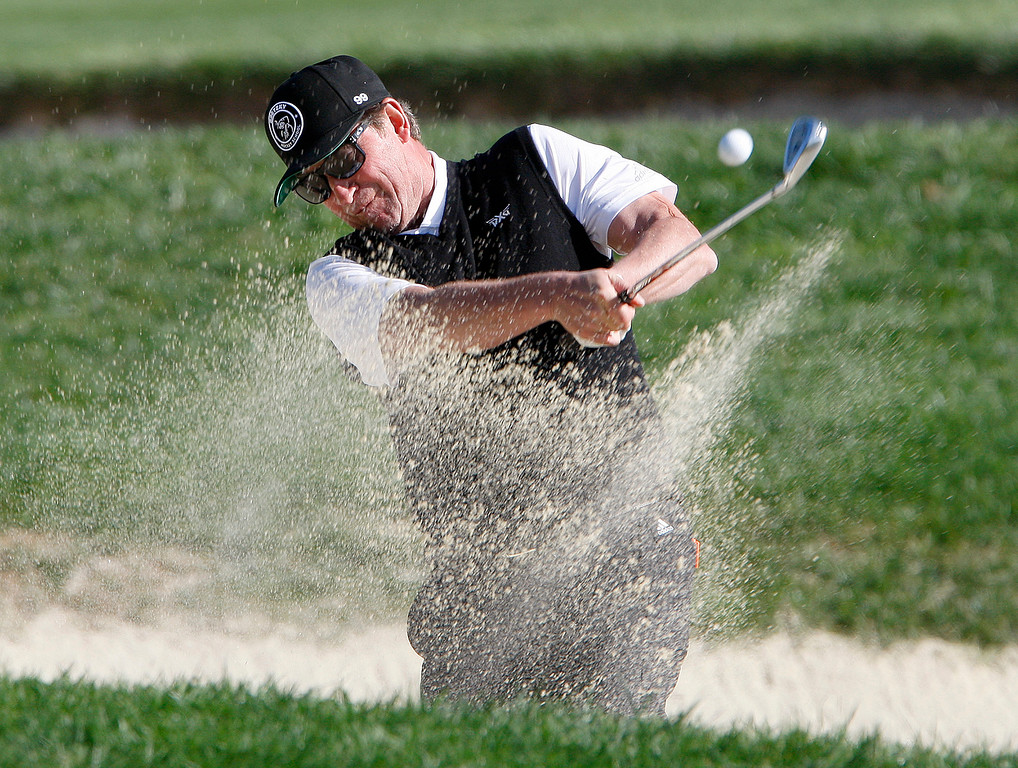 . Wayne Gretzky hits from a bunker on the 6th hole at the Pebble Beach Golf Links during the third round of the AT&T Pebble Beach Pro-Am on Saturday, Feb. 10, 2018.  (Vern Fisher - Monterey Herald)