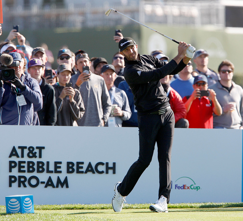 . Dustin Johnson tees off from the third hole at the Pebble Beach Golf Links during the third round of the AT&T Pebble Beach Pro-Am on Saturday, Feb. 10, 2018.  (Vern Fisher - Monterey Herald)