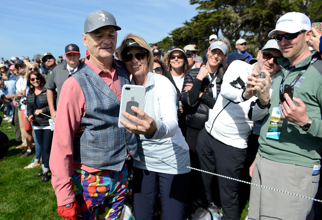. Bill Murray takes a photo with Karen Cunningham  at the Pebble Beach Golf Links during the third round of the AT&T Pebble Beach Pro-Am on Saturday, Feb. 10, 2018.  (Vern Fisher - Monterey Herald)