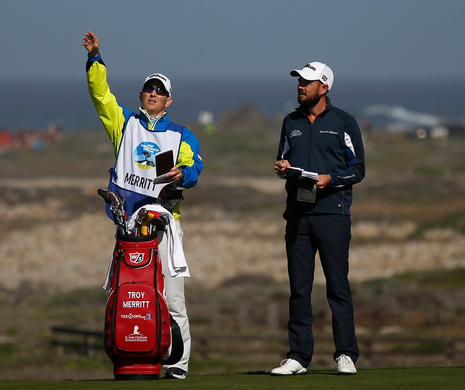 . Troy Merritt and his caddy check the wind direction on the 13th tee box at Monterey Peninsula Country Club during the third round of the AT&T Pebble Beach Pro-Am in Pebble Beach, Calif. on Saturday February 10, 2018. Merritt birdied the hole. (David Royal/Herald Correspondent)