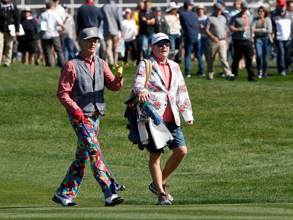 . Bill Murray walks with his caddy Andrew Whitaker on the 6th hole at the Pebble Beach Golf Links during the third round of the AT&T Pebble Beach Pro-Am on Saturday, Feb. 10, 2018.  (Vern Fisher - Monterey Herald)
