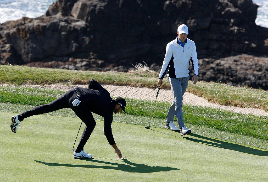 . Dustin Johnson and Jordan Spieth on the 8th hole at the Pebble Beach Golf Links during the third round of the AT&T Pebble Beach Pro-Am on Saturday, Feb. 10, 2018.  (Vern Fisher - Monterey Herald)