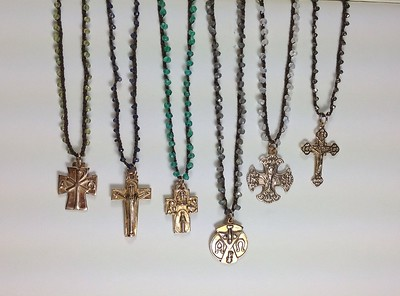 "FROM LEFT:  7-RM40-P-CO59 CROSS ON PERIDOT CROCHETED CORD, 7-RM203-I-CO58 CRUCIFIX ON CORD W/IOLITE, 7-RM53-AV-CO58 4 WAY CROSS ON AVENTURINE, 7-RM127-LAB-CO58 DOVE MEDAL ON CORD W/LABRADORITE, 7-RM257  O-MN-CO58, 7-RM164-PY-CO58 CRUCIFIX ON CORD W/PYRITE  ALL 17"" +2"