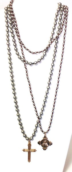 """LEFT: 7-RM265-GK6 CO55  RIGHT:  7-RM282-GK4 CO55  BRONZE MEDALS ON KNOTTED SILVER GLASS BEADS  36"""""""