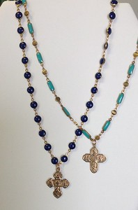MEDALS AND CROSSES ON COLORED ENAMEL CHAINS TO MIX AND MATCH. INEXPENSIVE ENOUGH TO BE A  GOOD ALTERNATIVE TO THE SEED BEAD NECKLACES AND MORE COLOR.  COLORS ARE BLUE, TURQ, RED, IVORY AND BLACK.  MOST COLORS AVAILABLE IN EITHER ROUND OR LONG LINKS.
