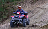Krystal Gaffney, of Hinsdale, N.H., goes up a hill on her four-wheeler on on Monday, April 5, 2021.