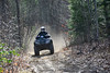 Alex Gaffney, of Hinsdale, N.H., goes down a trail on his four-wheeler on on Monday, April 5, 2021.