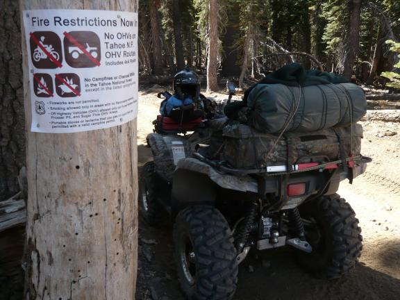 Fire restriction sign at border between Plumas and Tahoe national forest, which is also where Pacific Crest Trail crosses the ridge. The restrictions actually ended the night before at midnight.