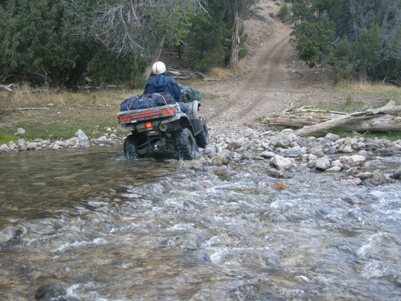 I'm making an easy stream crossing along Paiute Trail 15.