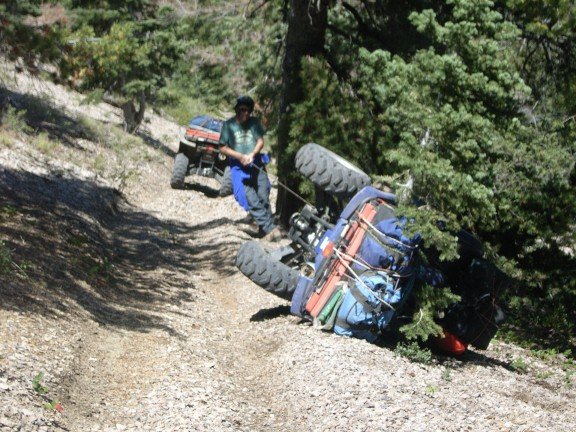 Here I am hauling out the winch cable from the Blue Grizzly so as to secure it to a tree. Didn't want it to take off when we rolled it back onto its wheels. My camo Grizzly had already made it past this point.