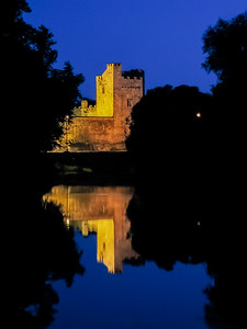Cahir Castle and the River Suir at night