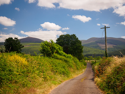 Minor road on the Tipperary Heritage Way, with the Knockmealdowns in the background