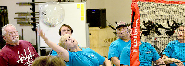 KEVIN HARVISON | Staff photo Participants in the Chair Volleyball tournament held at the Choctaw Nation of Oklahoma Wellness Center in Crowder attempts to return a volley.
