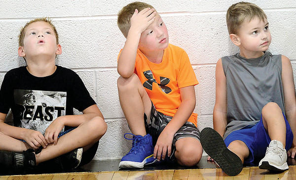 KEVIN HARVISON   Staff photo<br /> Pictrued from left, Jett Kerns, Jackson Hall and Cole Reed take a break during the Panther Pride Sumer Camp at PIttsburg. The camp is open to 1-6 grade and 7-12 grade sessons of speed, agility, strenght training and basketball skills.