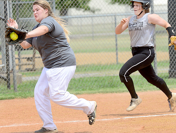 KEVIN HARVISON | Staff photo<br /> A Hartshorne defender attempts to get a a McAlester baserunner out during a scrimmage at the McAlester High School Softball Field Friday.