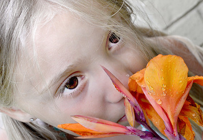 KEVIN HARVISON | Staff photo Kamryn Earnest takes time from her day to smell a flower.